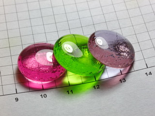 beads of Neodymium, Praseodymium and Erbium doped glass